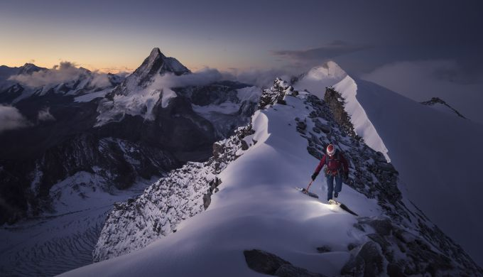 Climber on a mountain at sunrise